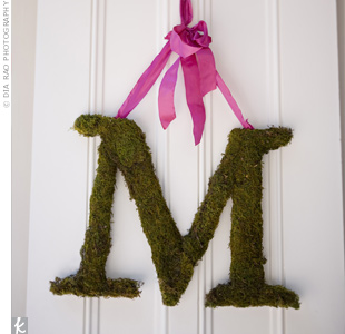 Megan and Paul's moss-covered initials hung from the church doors.