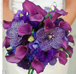 Emily's showstopping bouquet included bold purple vanda orchids mixed with fuchsia calla lilies.