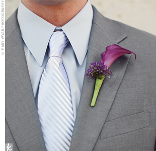 A simple calla lily on Nate's lapel kept the focus on his sleek, monochromatic look.