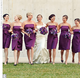 Emily's seven bridesmaids wore matching aubergine cocktail dresses.