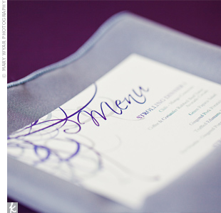 Soft gray napkins contrasted with the table linens, while the menu cards featured the same artsy design as the invitations and cake.