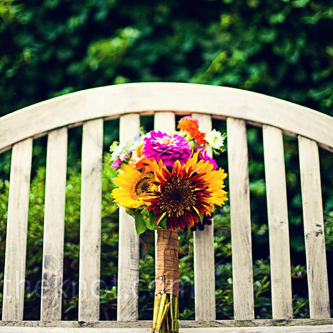 Laura wanted her bouquet to reflect the season, so she carried in-bloom flowers like sunflowers, zinnias and dahlias.