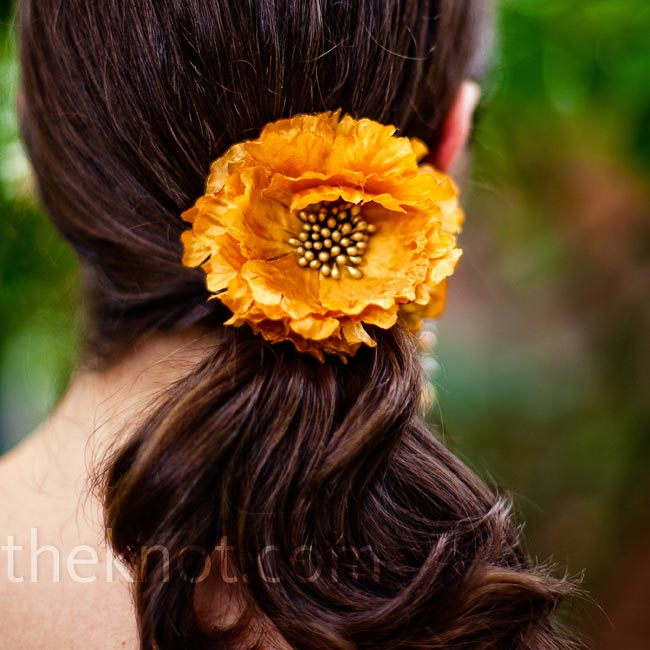 Laura's bridesmaids chose their own accessories, like this amber flower hairpiece.