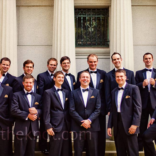 The guys kept it classic in black tuxes, with just bronze pocket squares for a hint of color.