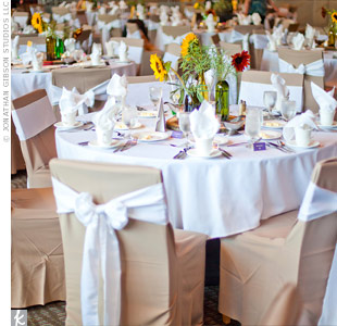Crisp white and beige linens provided a clean backdrop for the colorful sunflower centerpieces.