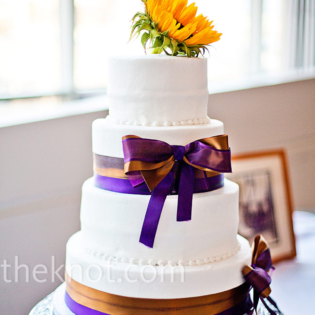 Bronze and purple bows mimicked Laura's gown, while a single sunflower was a fitting cake topper.