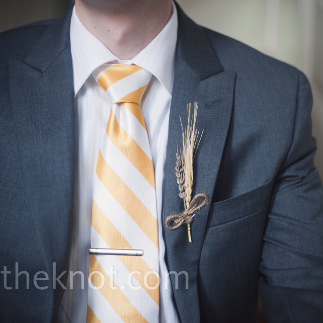 Dried wheat and lavender tied together with twine decorated Nat's lapel for a simple, earthy look.