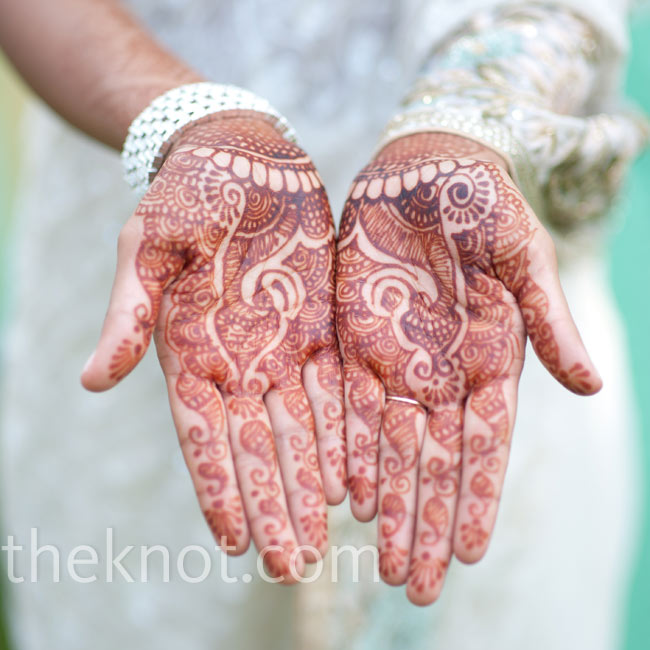 Mukti wore the traditional henna of an Indian bride on her hands.