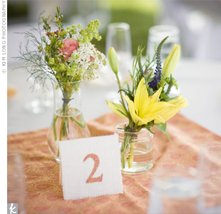 Herbs, such as mint, mixed with flowers gave the centerpieces a more organic and textured appearance.