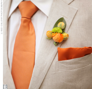 John wore bright-orange ranunculus buds to match his tie and pocket square.