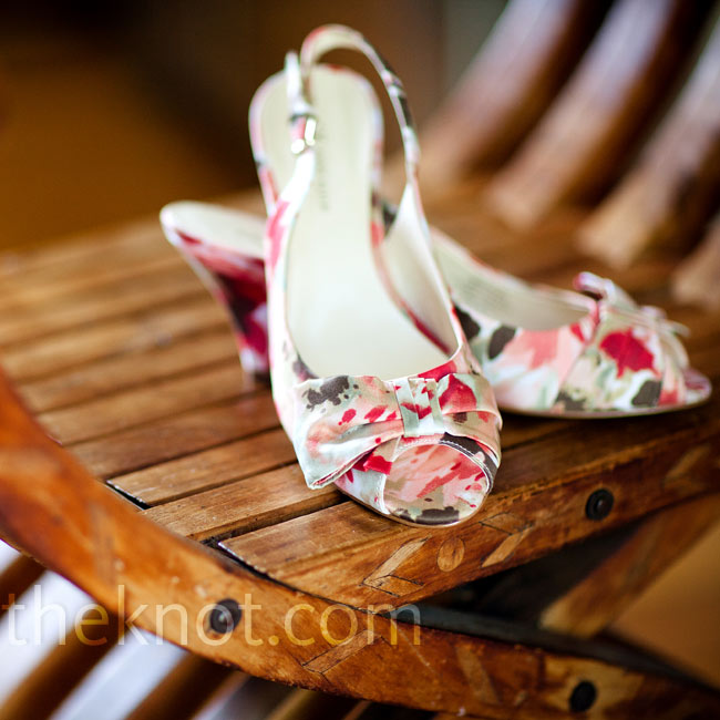 Shying away from traditional white shoes, the bride chose floral-patterned heels that went perfectly with the color palette of the day.