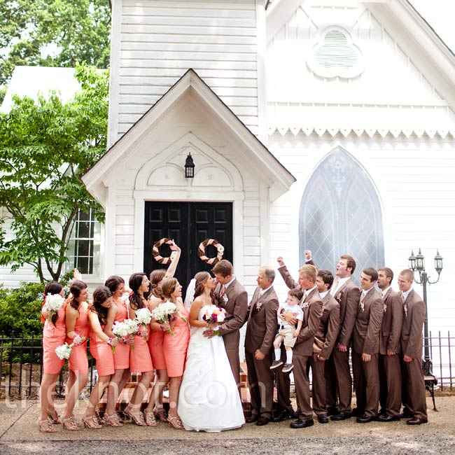 The bridesmaids wore knee-length dresses in a fresh coral color while the groomsmen wore brown suits accented with champagne ties.