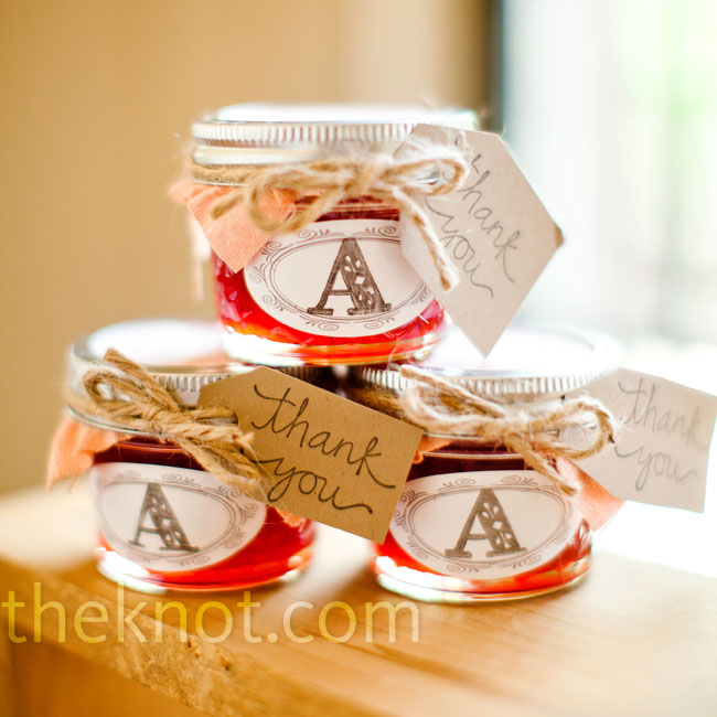The bride and her grandma made dozens of batches of strawberry jam in little Mason jars decorated with custom labels.
