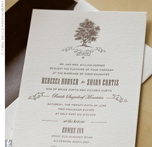 An elegant swirl design was paired with a tree motif on the letterpress invitations, complementing the wedding's vintage theme.