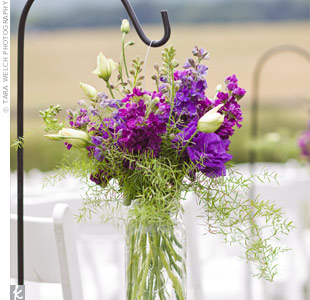 The aisle was lined with Mason jars of purple flowers hanging from shepherds hooks.