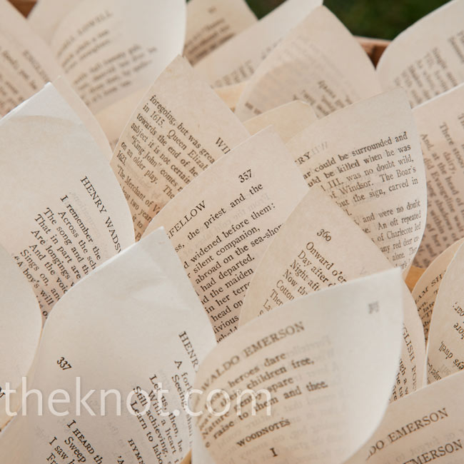 Rolled up pages from an English poetry book held freeze-dried flower petals for guests to toss.