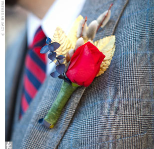 Alex's red rose boutonniere was accented with gold leaves, pussy willow and a sprig of blue eucalyptus.