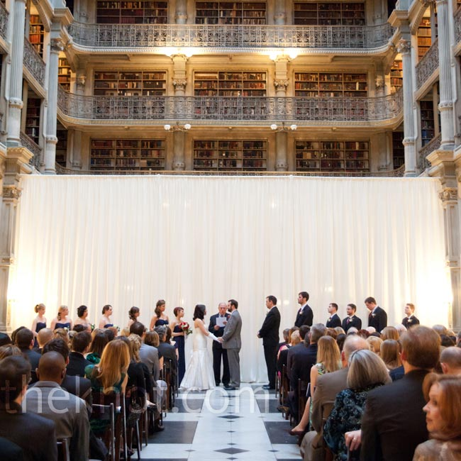 A white curtain defined the ceremony space, calling attention to the amazing architecture and soaring ceilings of the library.