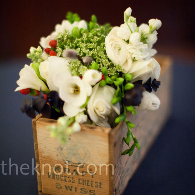 After the ceremony, the bridesmaid bouquets were placed in vintage wooden boxes on the cocktail tables.