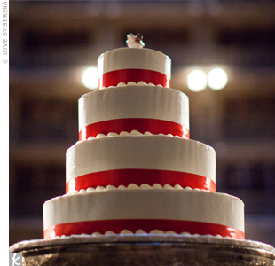 Red ribbon was wrapped around the base of each tier, while a small wren topped the cake as a nod to the groom's last name.