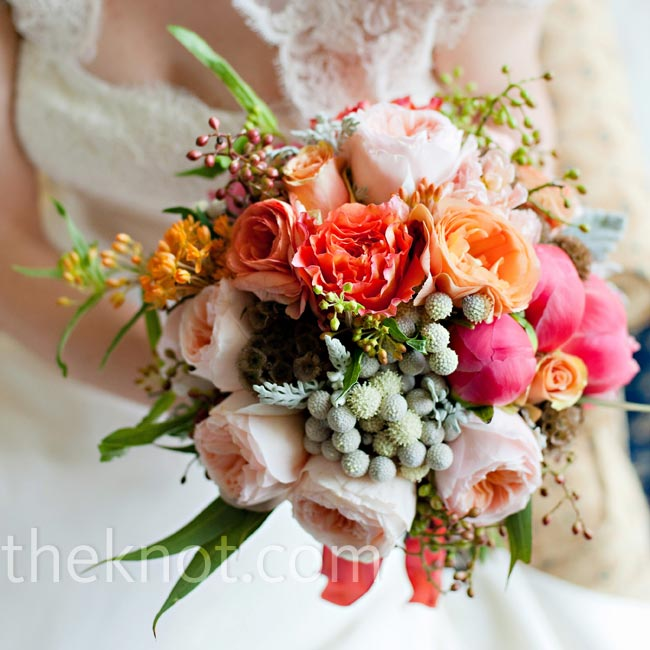 Susan carried a lush, textured arrangement of pink and coral blooms that looked as if it had been freshly picked from the estate's gardens.