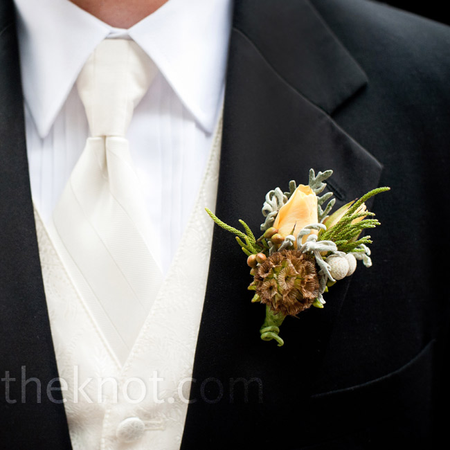 A unique combination of a scabiosa pod, dusty miller and an ivory rosebud made up Stefan's boutonniere.