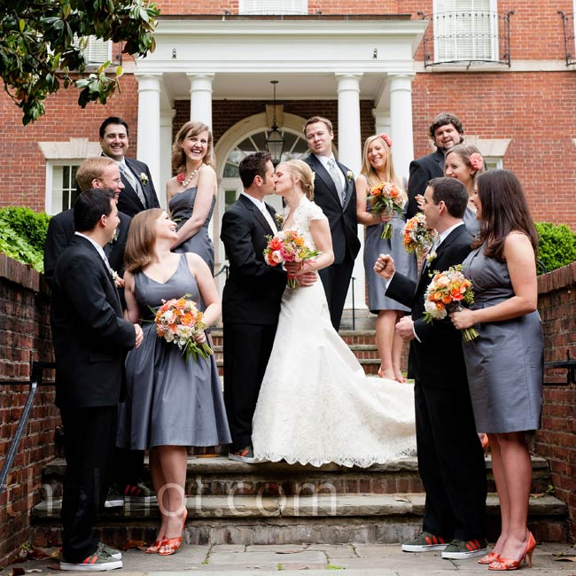 Coral heels added a fun pop of color to the gray bridesmaid dresses. Not to be left out, the groomsmen wore gray and coral Adidas soccer shoes.