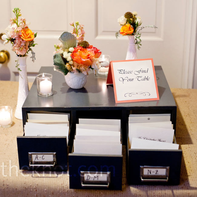 A nod to the couple's shared love of books, a vintage card catalog alphabetized the calligraphed escort cards.