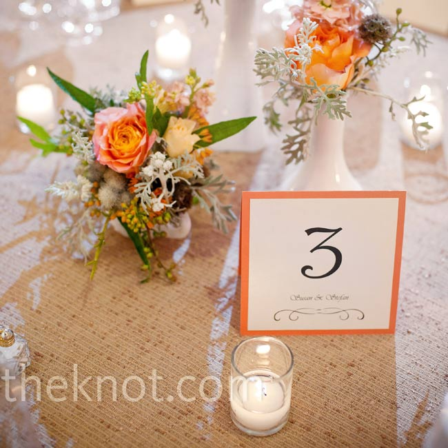 To encourage conversation across the tables, the couple chose low arrangements of milk glass vases filled with coral roses, hydrangeas, seeded eucalyptus and scabiosa pods.