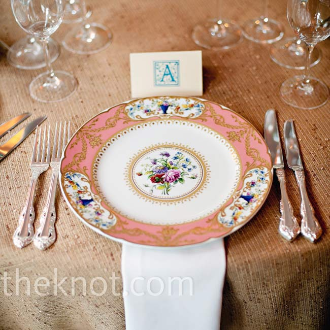 Vintage china in an ornate coral, blue and gold pattern was a colorful contrast to the rough burlap-like material used for the table linens.