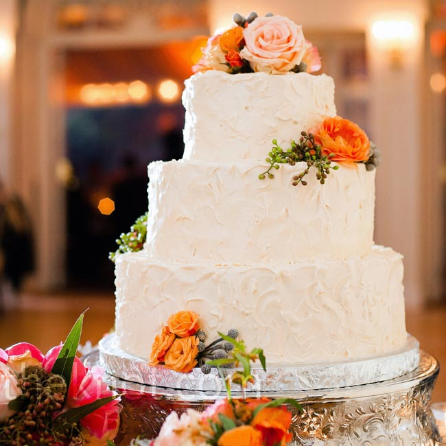 In keeping with their simple yet elegant aesthetic, the cake was frosted with textured buttercream and adorned with pink and coral blooms.