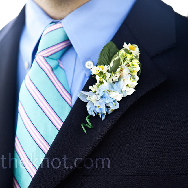 A boutonniere of blue delphinium complemented Brad's blue and lavender tie.