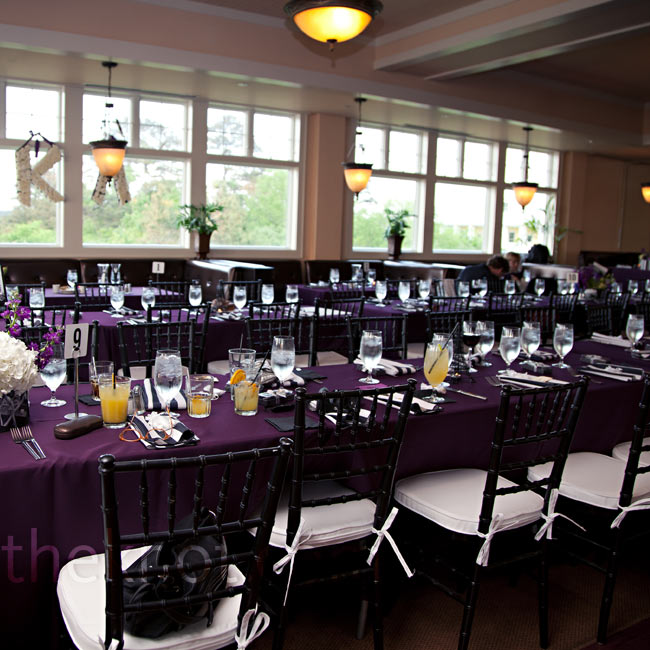 Deep purple linens covered the banquet-style tables while black-and-white striped napkins and black chiavari chairs added to the sophisticated feel.