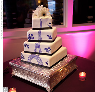 The Eiffel Tower was hand-painted in a deep purple color on the four offset tiers of the cake.