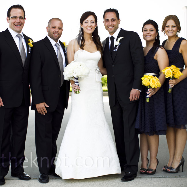 Adrienne's sisters wore matching navy organza dresses, while Justin's groomsmen wore black suits and silver ties.