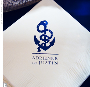 Napkins printed with a navy nautical motif were set on the cake table.