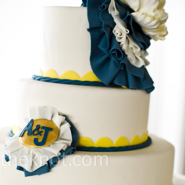 The cake's navy rope piping and yellow scallop design were subtle nods to the nautical theme, while fondant ruffles added a trendy bit of texture.