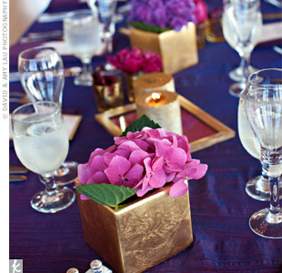 Half of the dinner tables were topped with gold hydrangea-filled boxes.