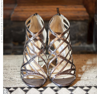 The bride chose sleek, metallic, gladiator-style heels to match her bag.