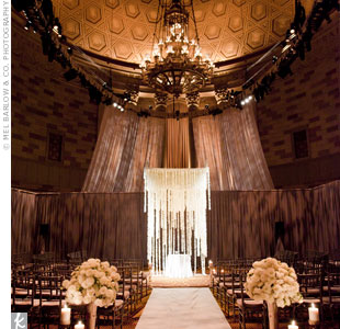 The couples all-floral huppah was suspended from above and uplit for a stunning scene.