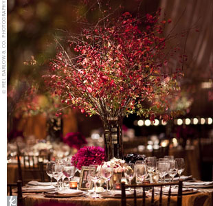 The taller arrangements at the reception were made 