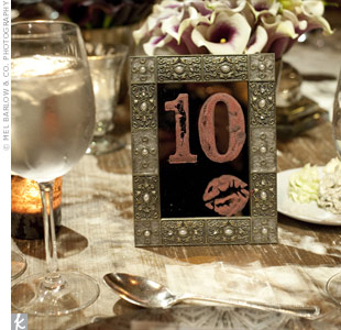 For the table numbers, Allison used vintage-style frames with mirrors set inside. She stamped on the numbers with a berry shade of lipstick.