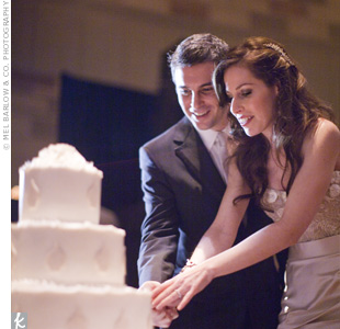 Allison and David cut their three-tiered fondant cake.
