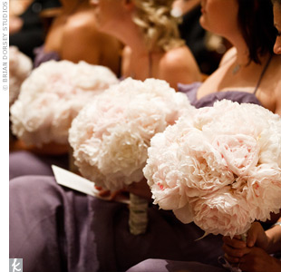 The bridesmaids carried round bouquets of open white peonies.
