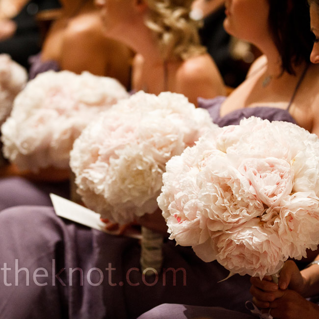 The bridesmaids carried round bouquets of 