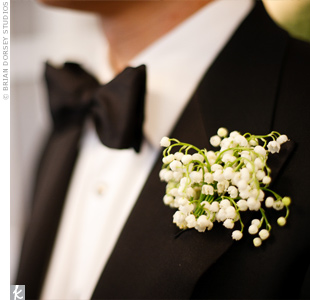 Will wore a boutonniere of lilies of the valley to match Chelseas bouquet.