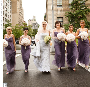 The bridesmaids wore long chiffon dresses in a romantic shade of violet.