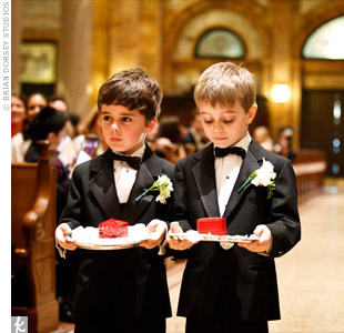 The two ring bearers, Chelseas cousins, wore black tuxedos and carried the rings in red boxes on silver platters.