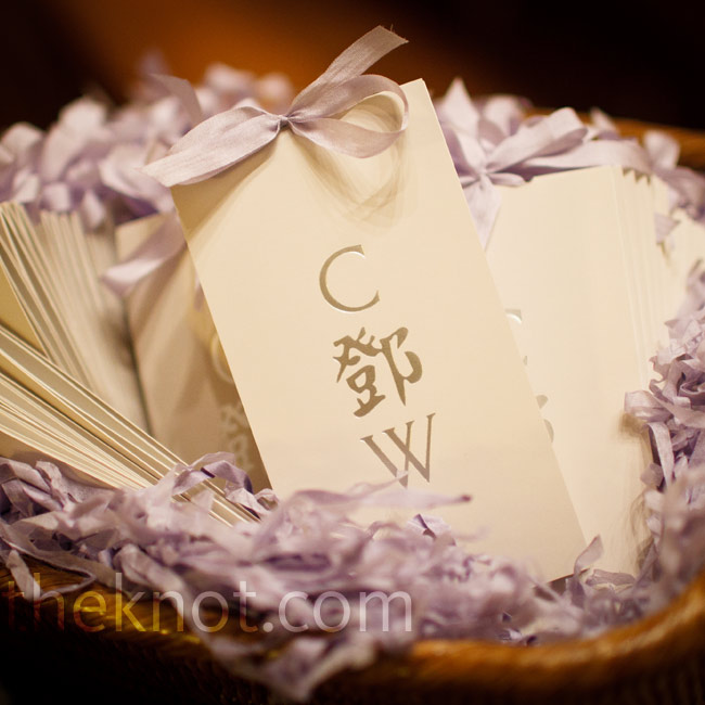 "Lavender ribbon finished the couple's traditional programs, which had their monogram, ""C Deng W"" (their last name is in Chinese), on the cover."