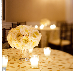 Small groupings of English garden roses, votives and gold-leaf embroidered linens decorated the cocktail hour.